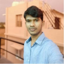 selfie picture of a man in blue shirt